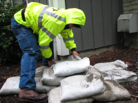 Person Laying Sandbags